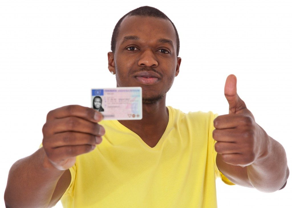 man with his driver's license