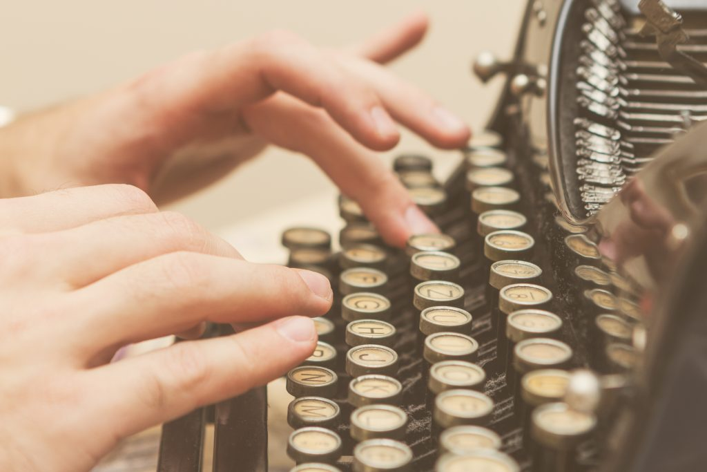 using an old typewriter