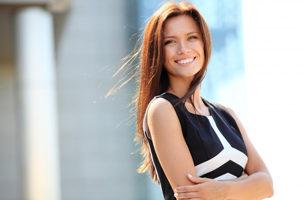 Confident woman posing with her arms crossed