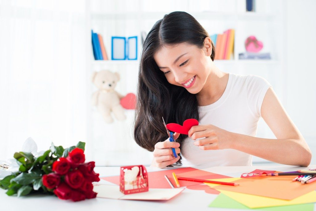 a woman doing arts and crafts