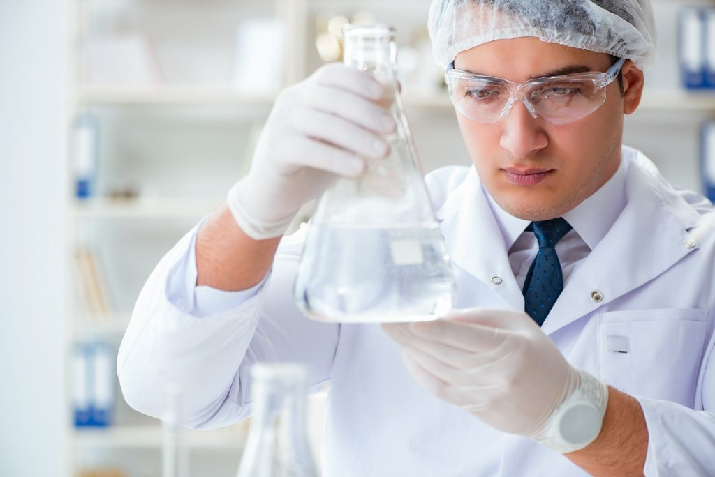 Professional examining the water