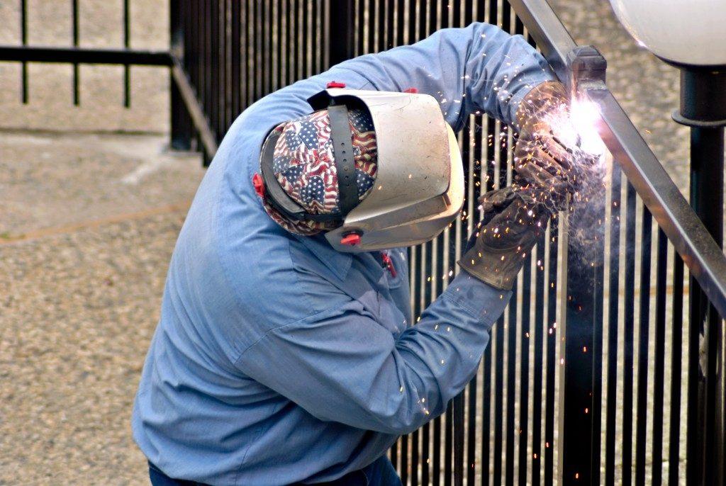 Fence installation worker