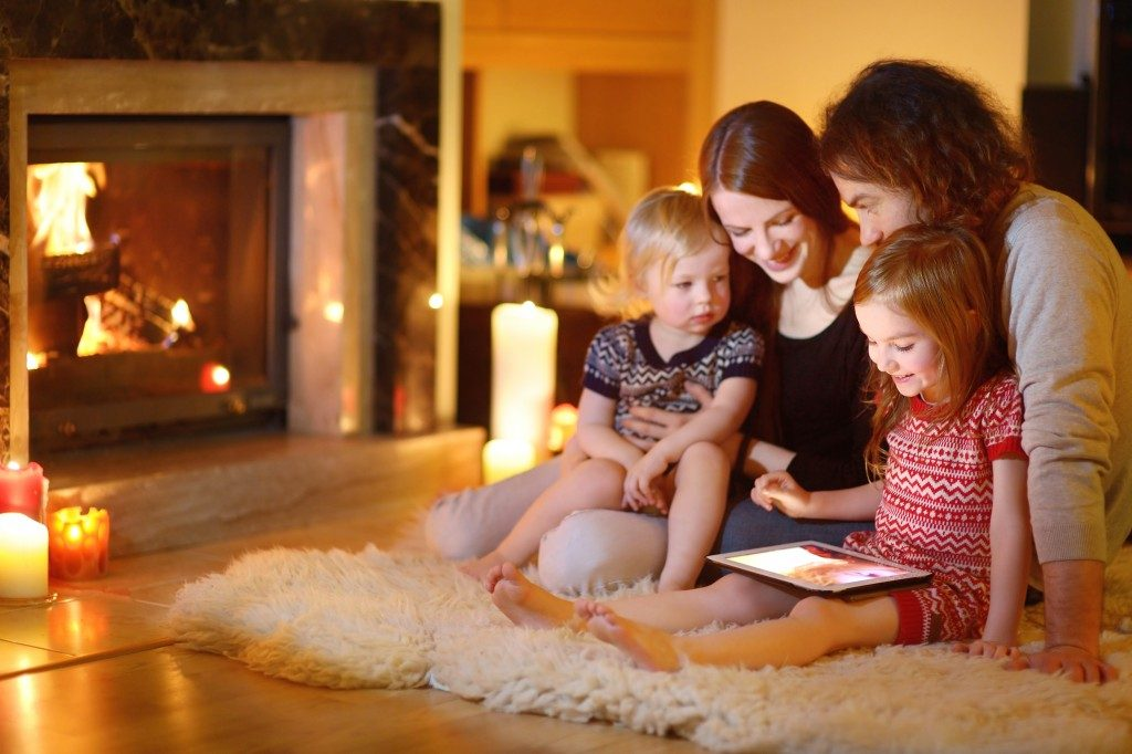 family in the lving room near the fireplace