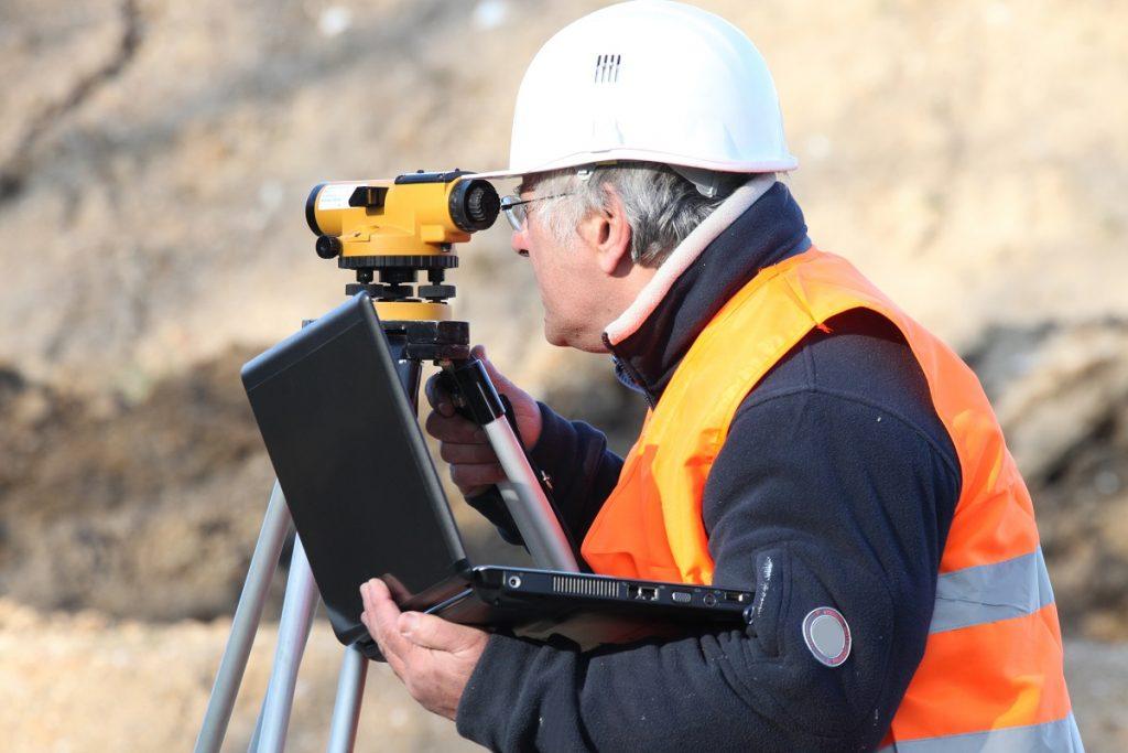 Engineer surveying the land