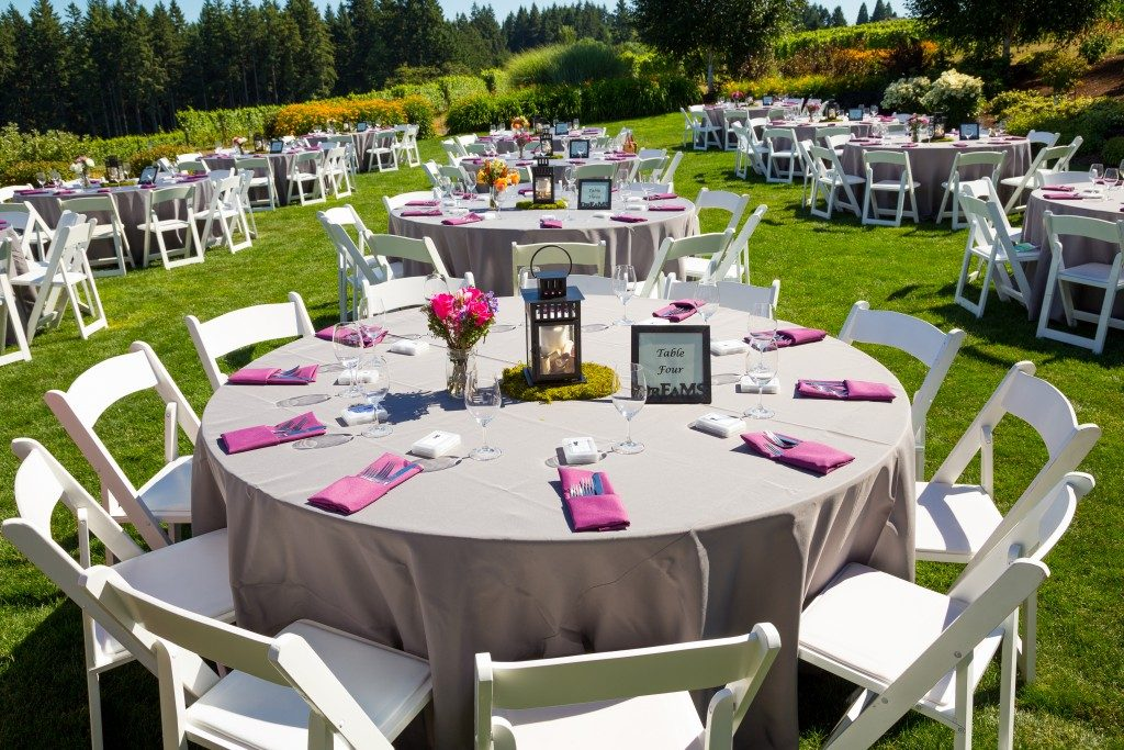 Tables, chairs, decor, and decorations at an outdoor venue