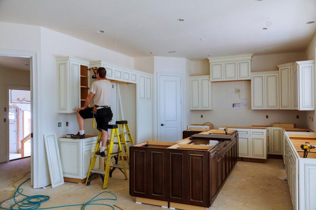 man repairing his kitchen