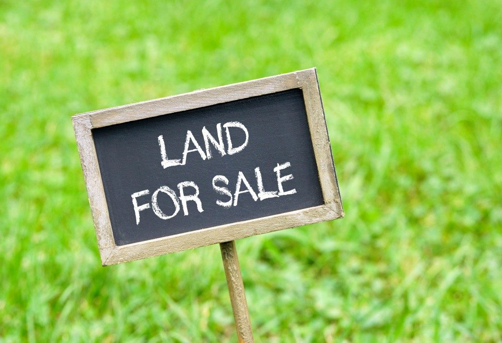 """Land for sale"" sign"