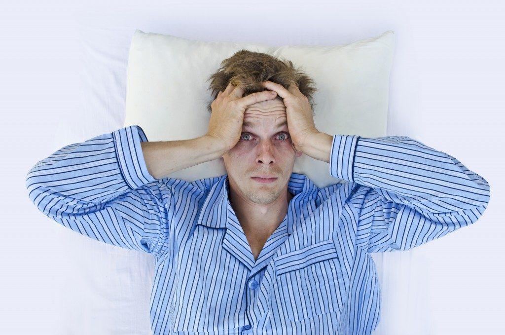 man having a hard time to sleep