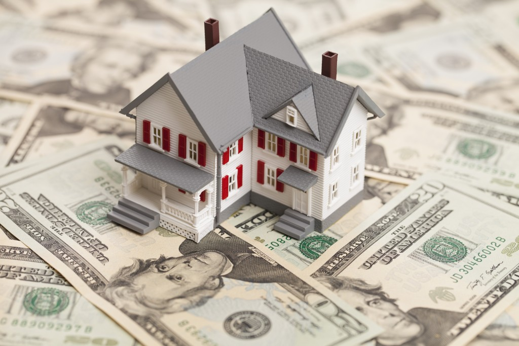 House Model on Top of Cash