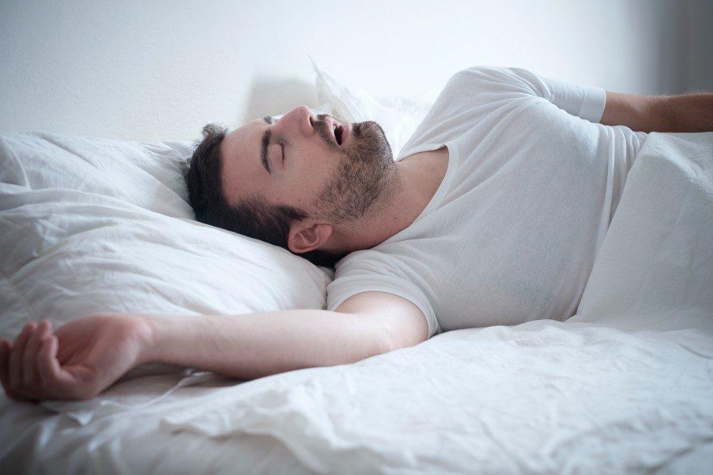 man snoring in his sleep