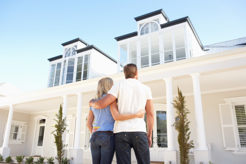 couple looking at their new modern house