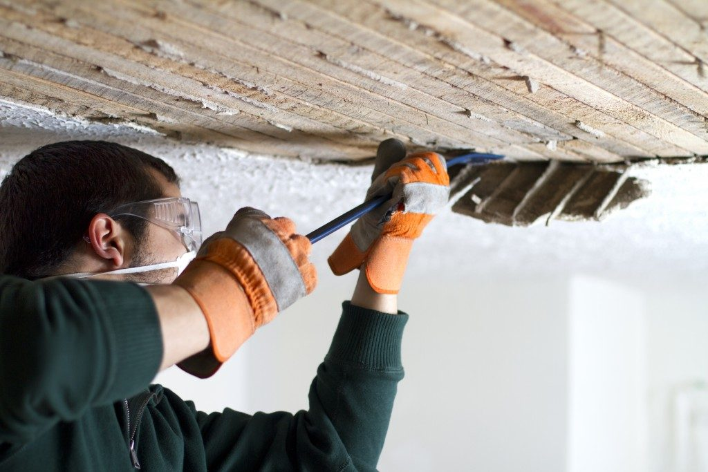 worker remodeling the ceiling