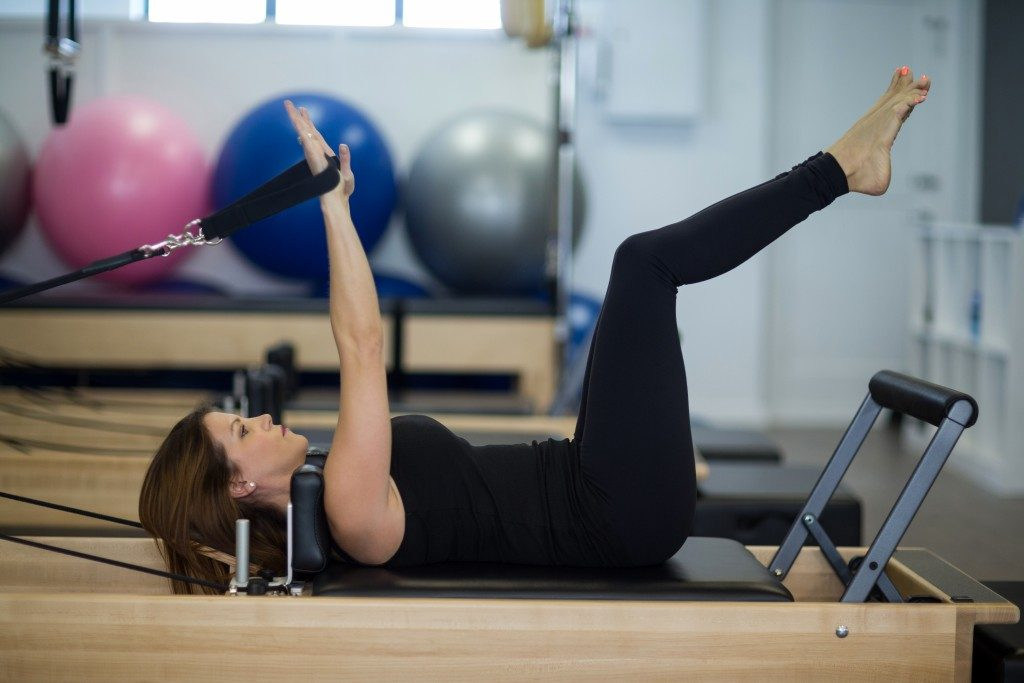 woman doing exercise in the gym