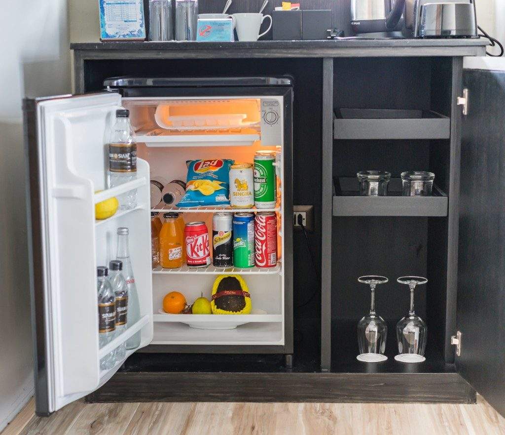small refrigerator loaded with snacks and beverages