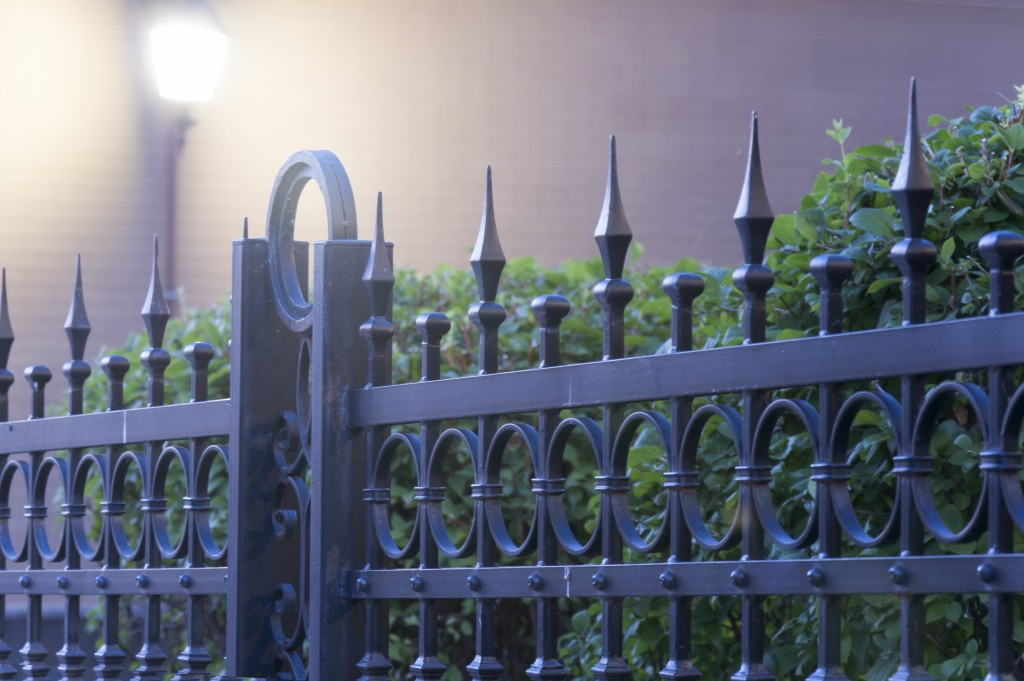 Metal fence with light at the background