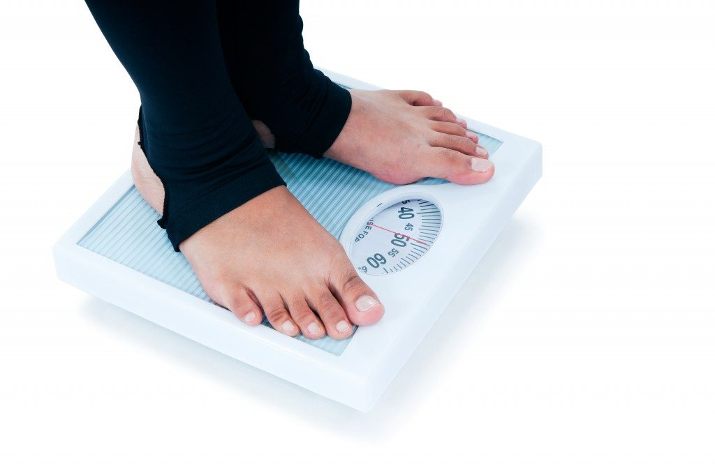 Close-up of a female feet standing on weighing scale