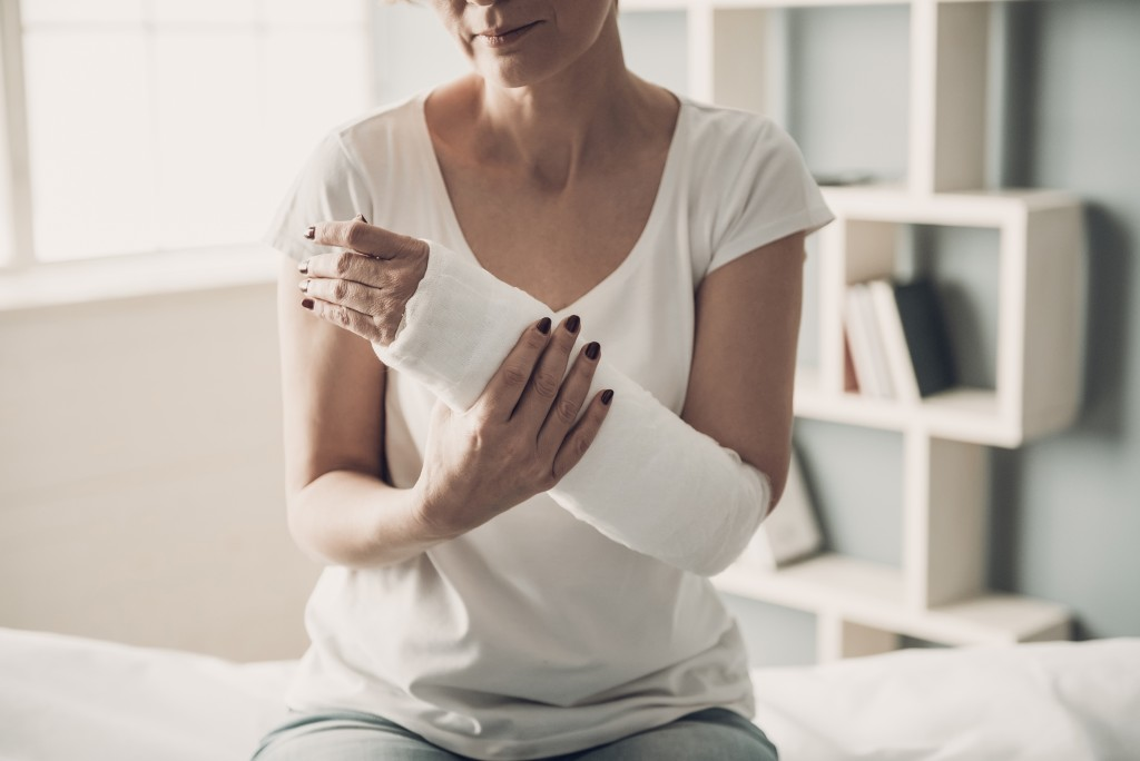 woman's left arm bandaged after injury