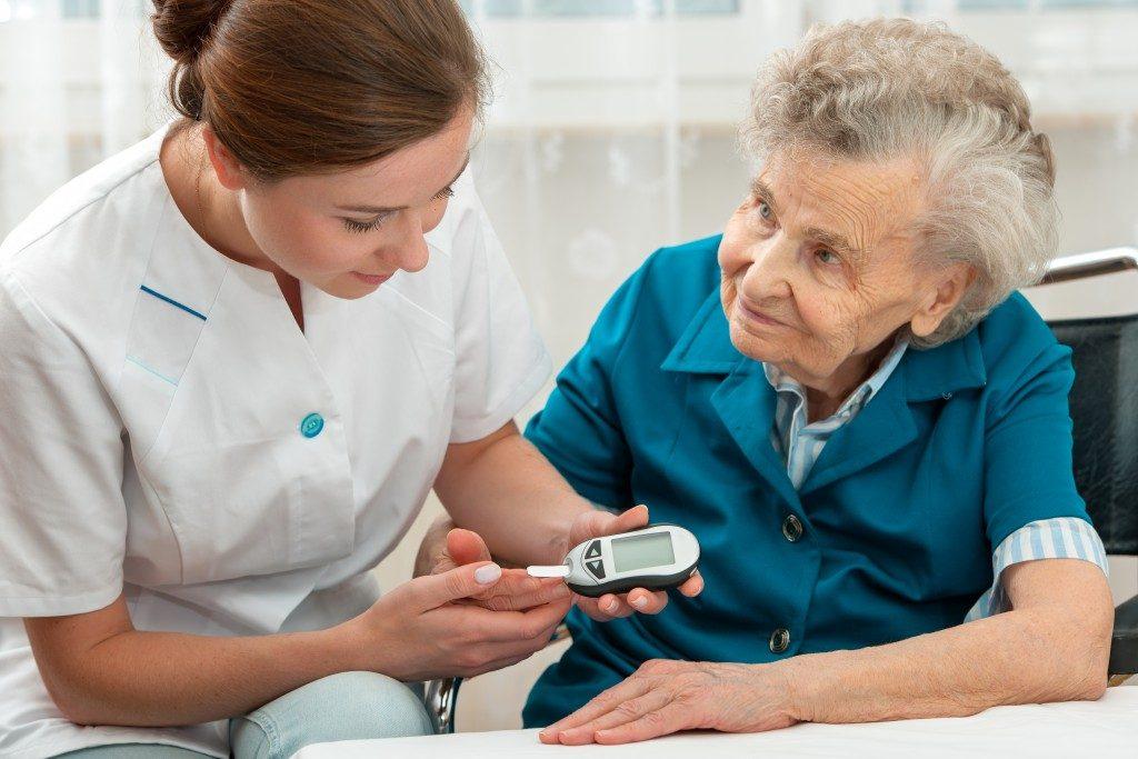 Nurse getting blood of elderly