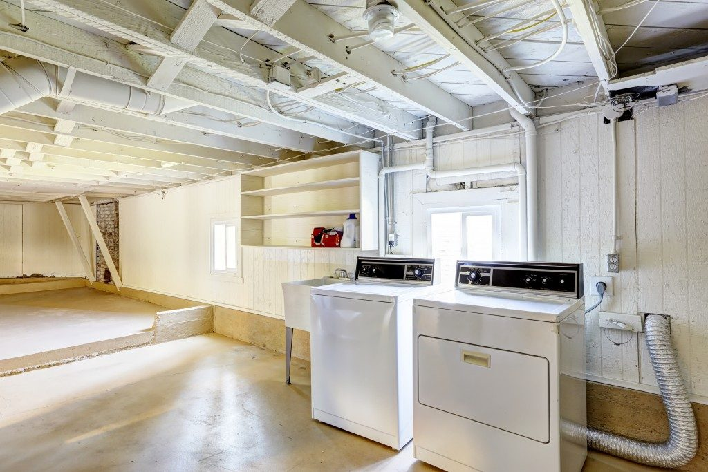empty basement with laundry