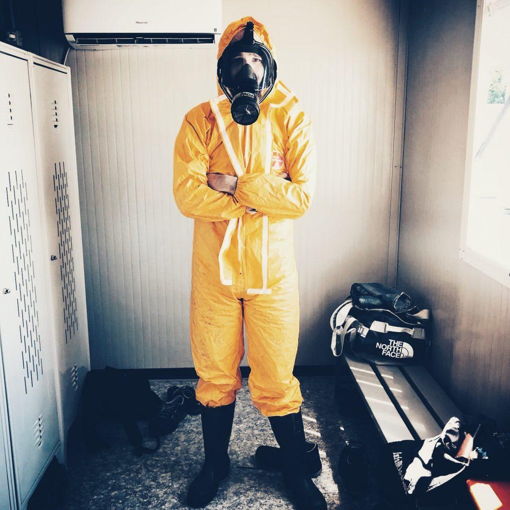 Man wearing a hazmat suit