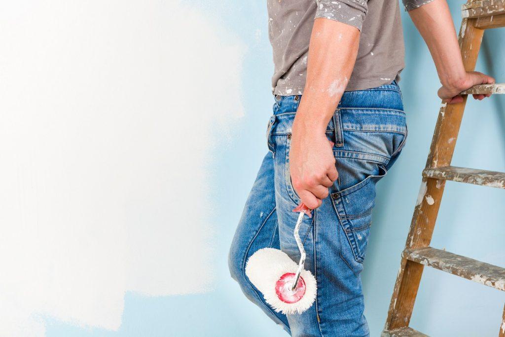 man holding a paint roller