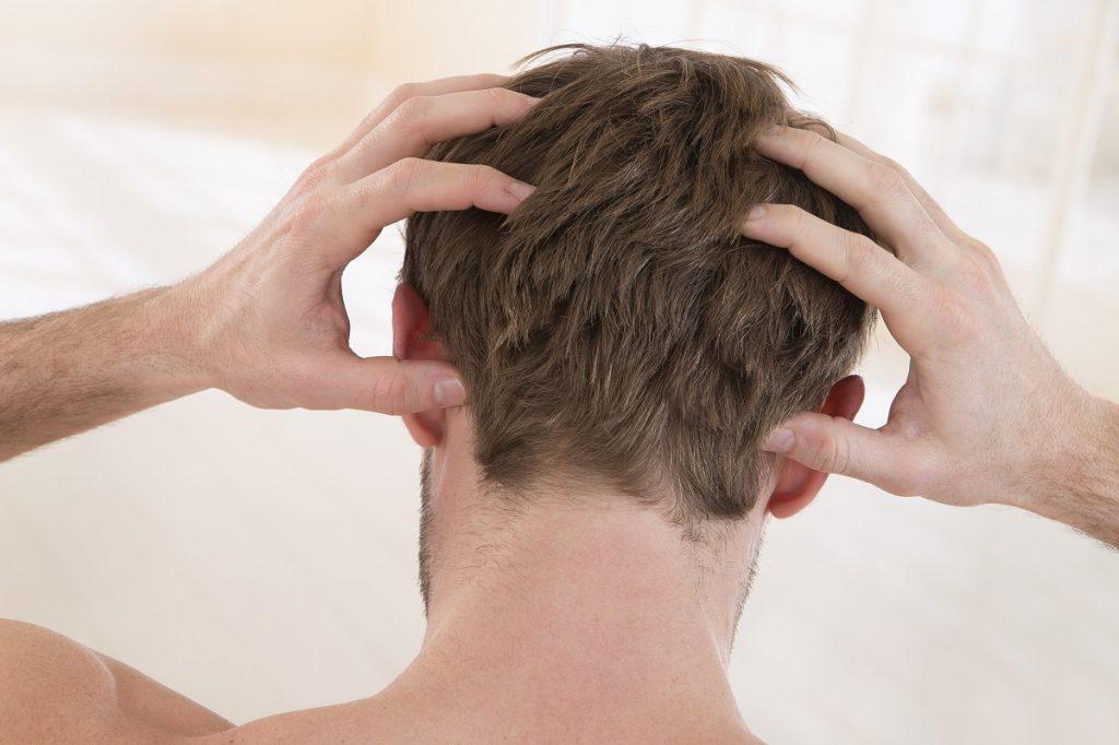 Man scratching scalp