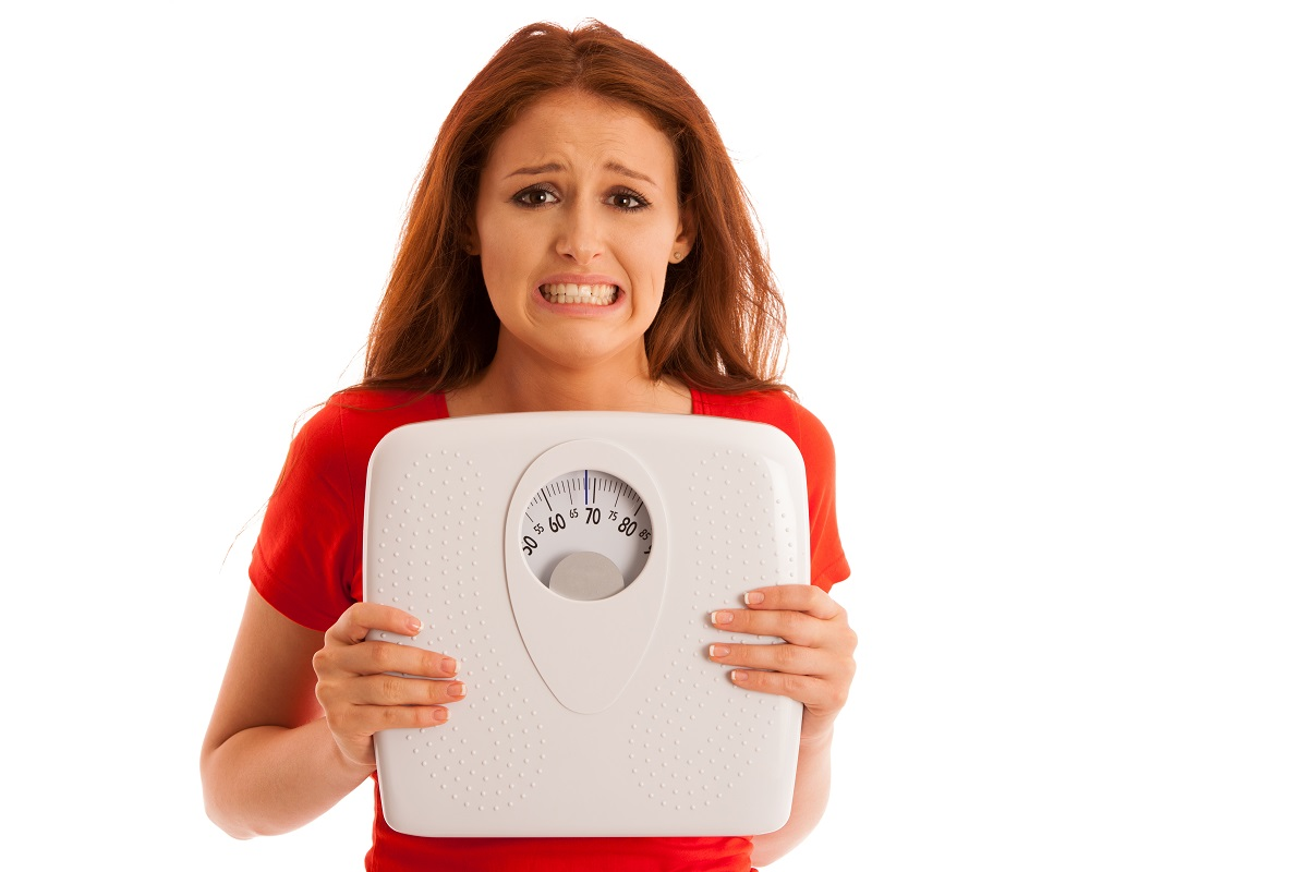 girl  with weighing scale