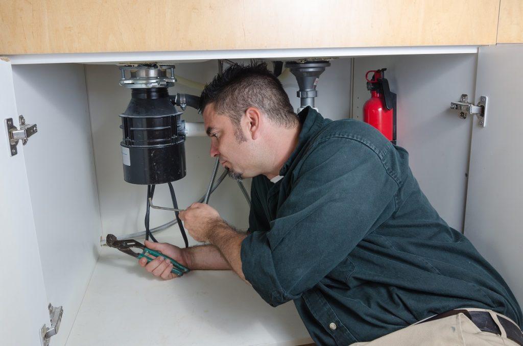 Plumber fixing waterpipes