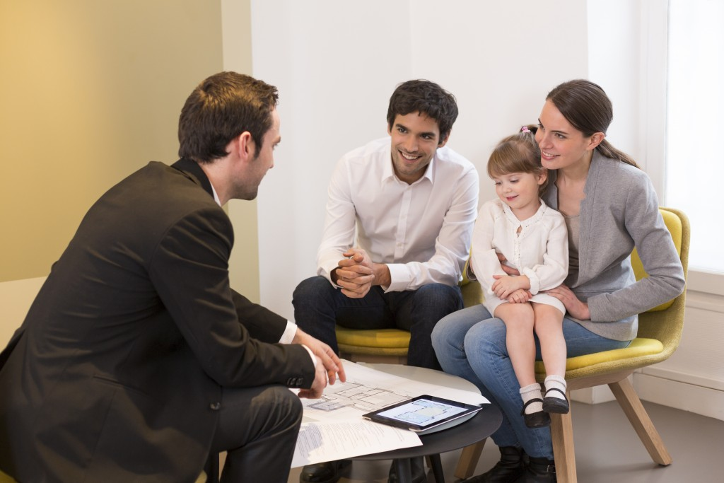 Salesman talking to a family