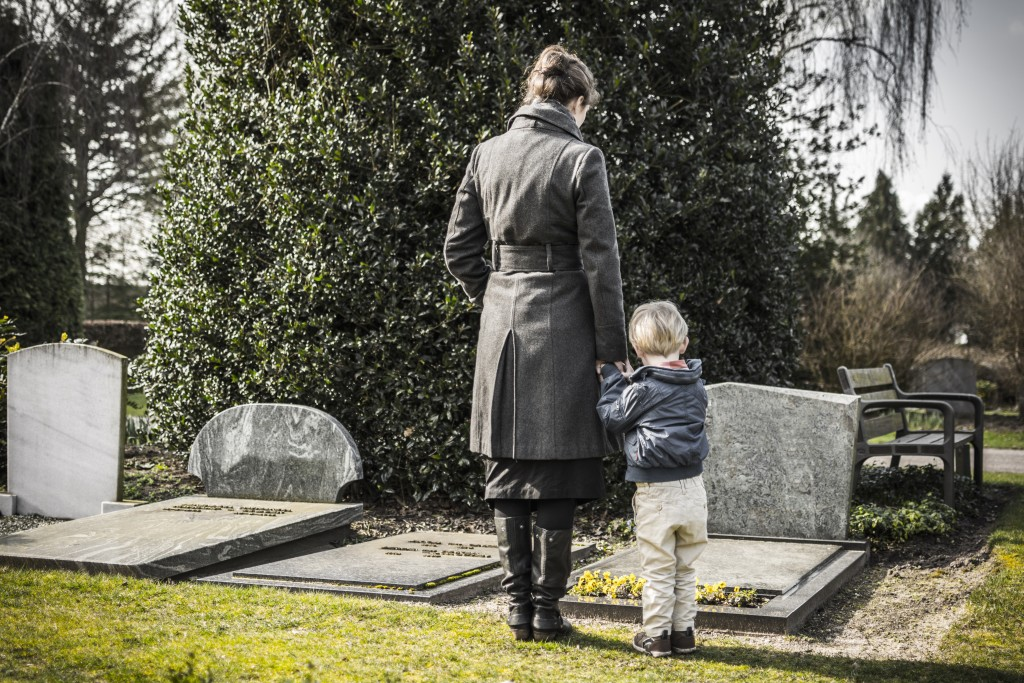 mother and child at a cemetery
