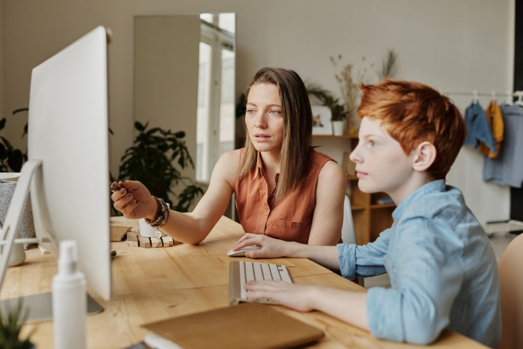 mother son taking an online class together