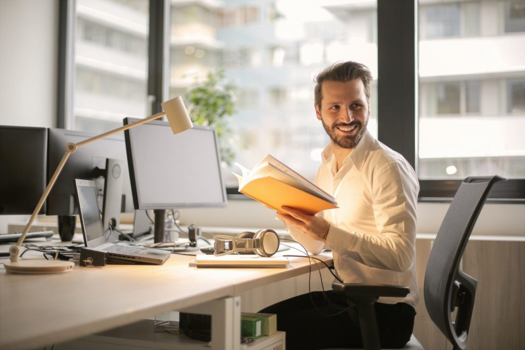 man working happily at home
