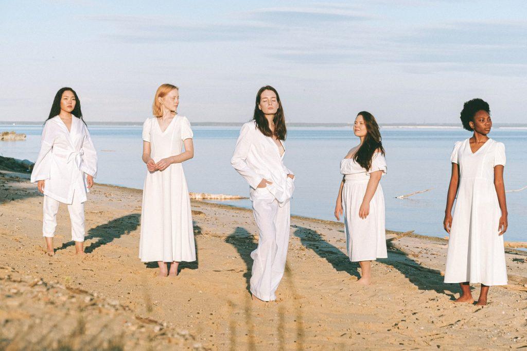 women standing at the beach