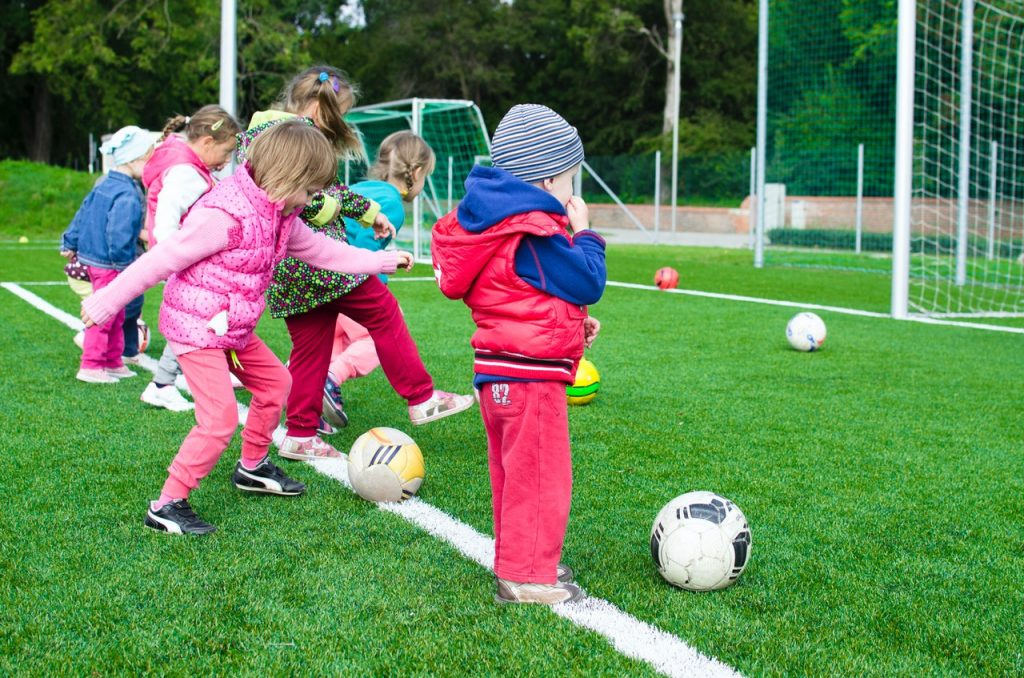 children playing football soccer