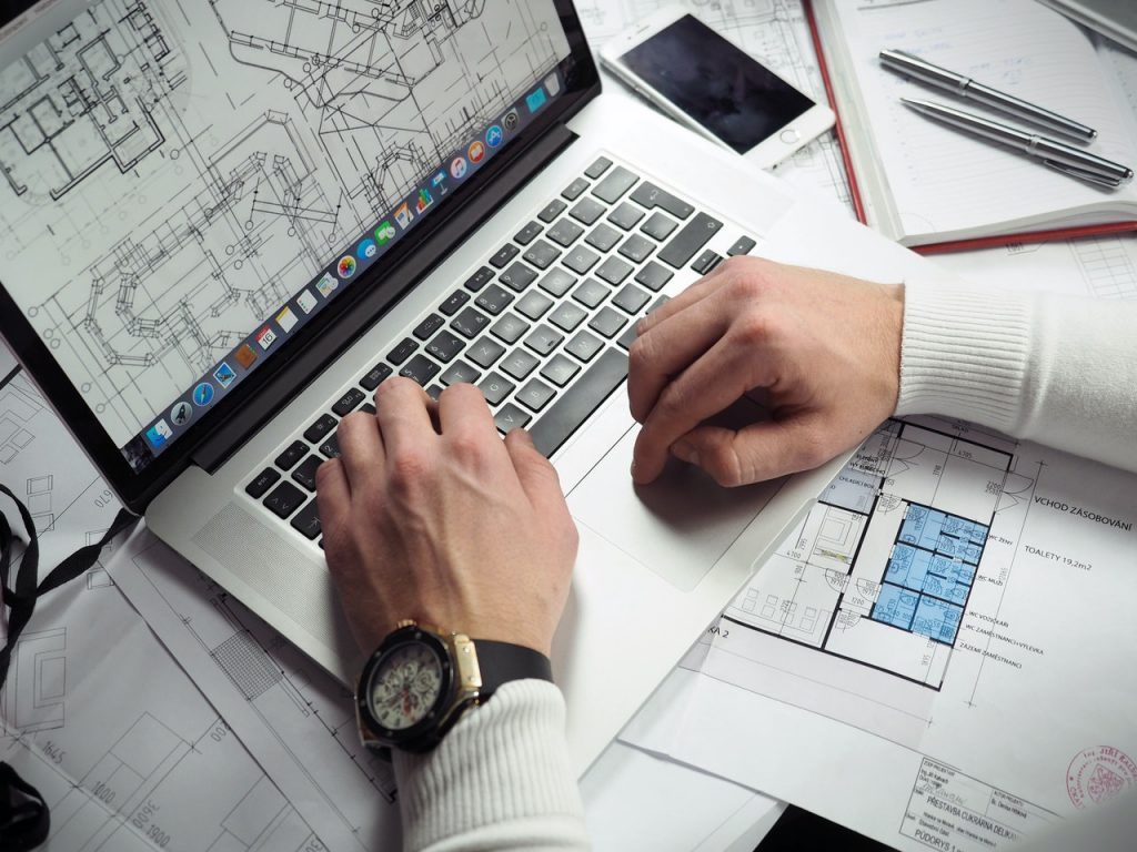 man making blueprints