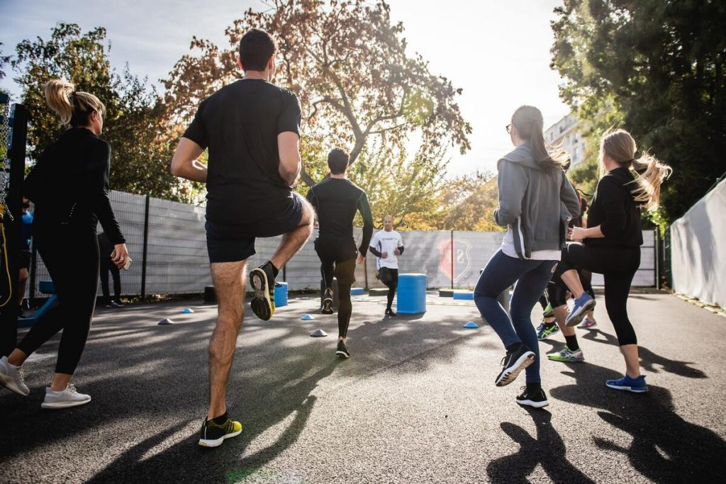 family exercising in their backyard